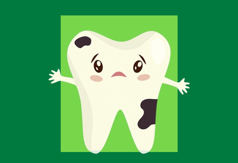 imagem de dente branco com manchas pretas e semblante triste